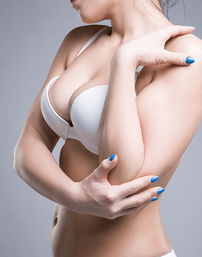 Breast lift surgery performed by Allure Cosmetic Clinic surgeons.